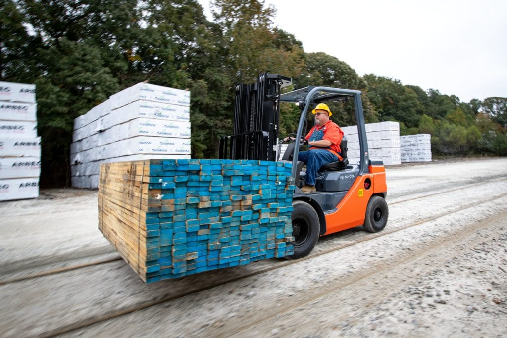 toyota pneumatic forklift carrying load of lumber