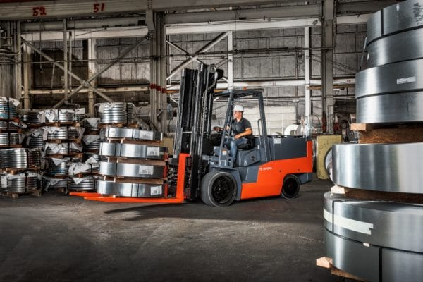 toyota high capacity electric forklift carrying load of steel