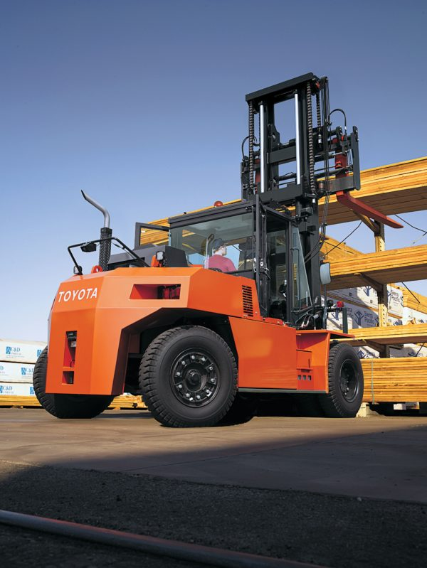 toyota high capacity forklift lifting lumber