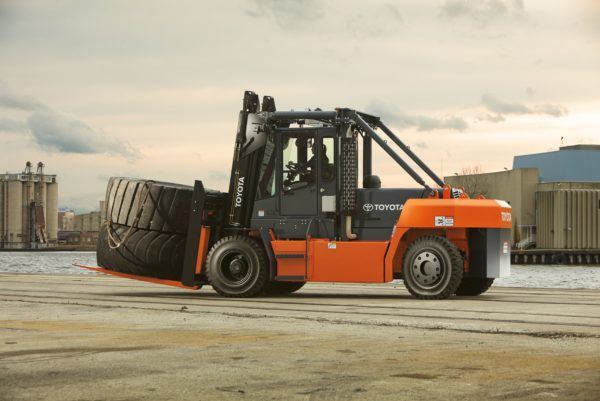 toyota high capacity forklift carrying large tire