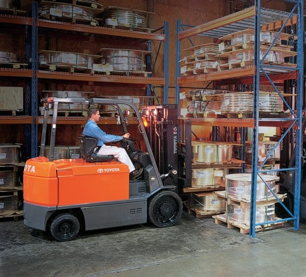 toyota large electric forklift reaching into pallet rack
