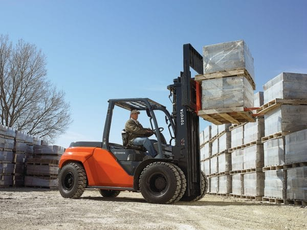 large toyota forklift lifting concrete blocks outdoors