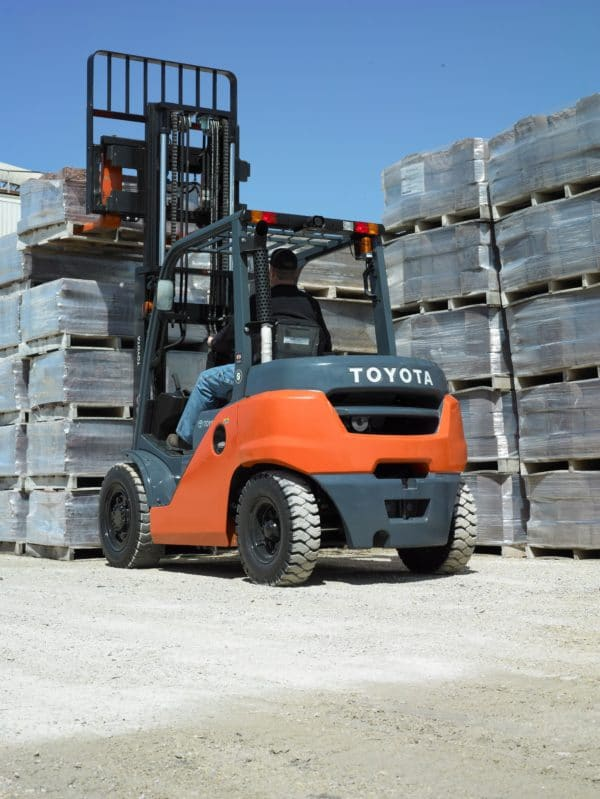 toyota pneumatic forklift lifting load outdoors