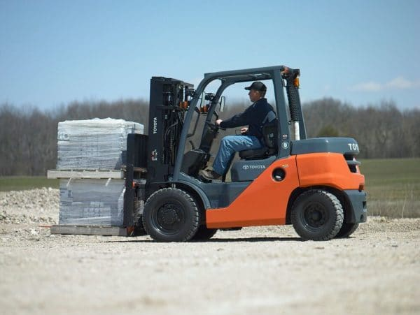 toyota pneumatic forklift carrying load outdoors