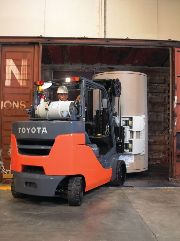 toyota paper roll special forklift backing out of railcar