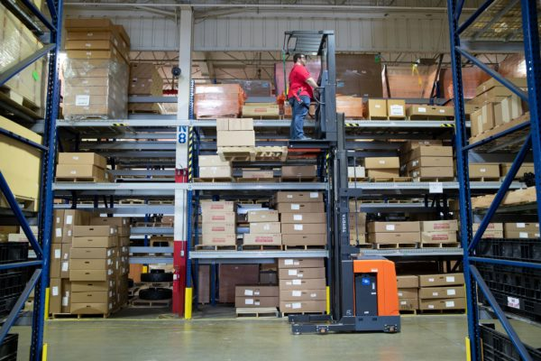 toyota 8 series order picker picking orders from pallet rack