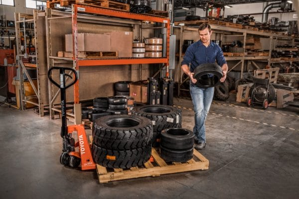 toyota hand pallet jack with load of tires